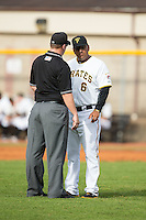 Bristol Pirates manager Edgar Varela (6) listens as umpire Ryan Barneycastle explains a call to him during the game against the Johnson City Cardinals at Boyce Cox Field on July 7, 2015 in Bristol, Virginia.  The Cardinals defeated the Pirates 4-1 in game one of a double-header. (Brian Westerholt/Four Seam Images)