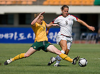 USWNT forward (8) Lauren Cheney has the ball poked away from her by Australia's (19) Clare Polkinghorne during the Peace Queen Cup  in Suwon, South Korea.  The U.S. defeated Australia, 2-1, at the Suwon Sports Complex.
