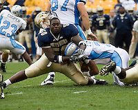 Pitt Panthers Defensive Lineman Rashaad Duncan gets his helmet knocked off as he attempts to tackle a Citadel Bulldog running back. The Panthers beat the Bulldogs 51-6 on September 23, 2006 at Heinz Field, Pittsburgh, Pennsylvania.