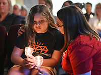 """NWA Democrat-Gazette/CHARLIE KAIJO Amy Gillespie of Bella Vista (right) comforts her daughter Evie Gillespie, 10, during a vigil, Thursday, August 8, 2019 at the All Saints' Episcopal Church in Bentonville.<br /> <br /> Moms Demand Action of Benton County held a candle light vigil to honor the victims of the El Paso, TX. and Dayton, OH. shootings that took the lives of 31 people. About 120 people attended the vigil. Attendees listened to impassioned speakers and participated in a moment of silence and prayer. Afterwards, organizers handed out postcards to mail to Arkansas Senators Tom Cotton and John Boozeman and Kentucky Senator Mitch McConnel urging them to support House Resolution 8 which would require backgrounds checks on all gun sales or transfers. <br /> <br /> Brandi Gonzalez, a former El Paso resident of six years, brought her two children to the vigil wearing matching """"El Paso Strong"""" t-shirts. """"Shock,"""" she said of her reaction to hearing the news. """"I worked across the street from the Walmart. That's where we went shopping. My kids are Mexican American. I don't want them to feel ashamed for who they are and where they come from or what their background is."""""""