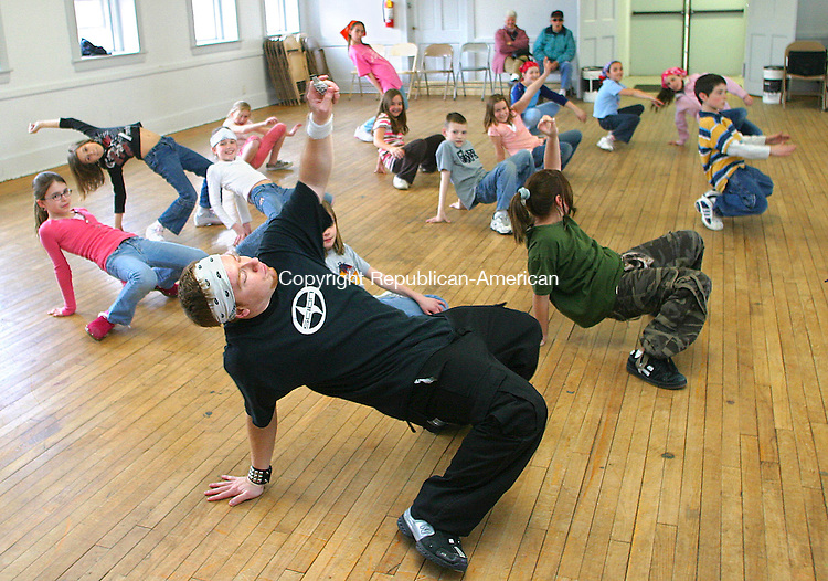 PROSPECT, CT- 30 MARCH 2007 - 033007JW01.jpg  -- Hip hop dance instructor Austin Dailey shows some of his 19 students a finishing pose during the last class of the Prospect Youth Services Friday afternoon at the Prospect Grange. Prospect Youth Services Director Lori Kennedy said the 6 week class was a hit with the students and they would try to schedule another class soon. Jonathan Wilcox Republican-American