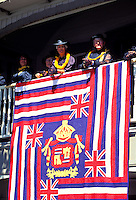Aloha Festival with Aunties watching above the  Hawaiian flag quilt on display, Waimea, Big island of Hawaii