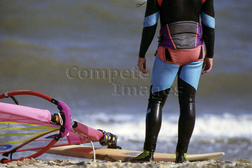Windsurfer watching the waves
