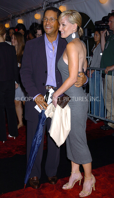 BRYANT GUMBEL  and WIFE  at 'I Robot' New York Premiere. July 14, 2004. Please byline: AJ SOKALNER/ACEPIXS.COM   .. *** ***..Ace Pictures, Inc:  ..Contact: Alecsey Boldeskul (646) 267-6913 ..Philip Vaughan (646) 769-0430..e-mail: info@acepixs.com