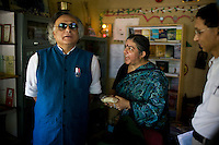 Dr. Vandana Shiva (center) shows different grains and seeds to the Minister of Environment, Sr. Jairam Ramesh, in Navdanya office in Dehradun, Uttarakhand, India, on 6th September 2009...Dr. Vandana Shiva, the founder of Navdanya Foundation and Bijavidyapeeth, is a physicist turned environmentalist who campaigns against genetically modified food and teaches farmers to rely on indigenous farming methods.. .Photo by Suzanne Lee / For The National