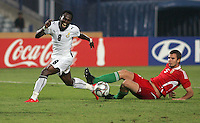 Ghana's Emanuel Agyemang-Badu (8) yells after leaping over Hungary's Andras Debreceni (5) during the FIFA Under 20 World Cup Semi-final match at the Cairo International Stadium in Cairo, Egypt, on October 13, 2009. Costa Rica won the match 1-2 in overtime play. Ghana won the match 3-2.