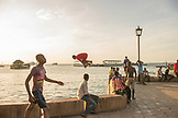 ZANZIBAR,Stone Town, Young Boys are playing and jumping to the Water from City's Wall