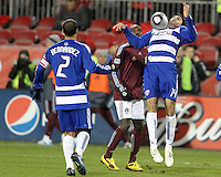 George John#14 of FC Dallas pulls in a high ball in front of Omar Cummings#14 of the Colorado Rapids during MLS Cup 2010 at BMO Stadium in Toronto, Ontario on November 21 2010. Colorado won 2-1 in overtime.