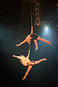 """London, UK. 14.04.2015. Circolombia presents """"Acelere"""" at the Roundhouse. Picture shows: Aerialists Soledad Gomez Acevedo and Oscar Mauricio Rojas Guasca, on straps. Photograph © Jane Hobson."""