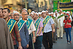 Members of Egyptian sufi muslim group parade the street during a ritual to commemorate the Hijri New Year, also known as Islamic New Year, in Cairo on October 26, 2014. The Islamic year lasts for about 354 days and consists of 12 months. Muharram is the first month and some Muslims mark the start of the Islamic year on the first day of Muharram. Photo by Amr Sayed