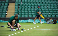 Groundsmen preparing Centre Court<br /> <br /> Photographer Ashley Western/CameraSport<br /> <br /> Wimbledon Lawn Tennis Championships - Day 9 - Wednesday 12th July 2017 -  All England Lawn Tennis and Croquet Club - Wimbledon - London - England<br /> <br /> World Copyright &not;&copy; 2017 CameraSport. All rights reserved. 43 Linden Ave. Countesthorpe. Leicester. England. LE8 5PG - Tel: +44 (0) 116 277 4147 - admin@camerasport.com - www.camerasport.com