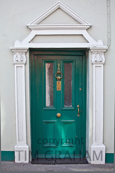 Brightly coloured turquoise door and Georgian style arch in Youghal, East Cork, County Cork, Southern Ireland
