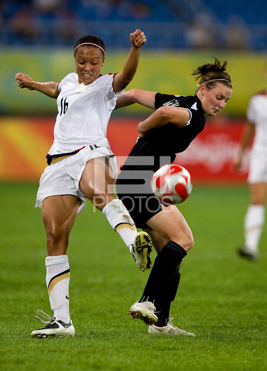 Angela Hucles, Anna Green. The USWNT defeated New Zealand, 4-0, during the 2008 Beijing Olympics in Shenyang, China.  With the win, the USWNT won group G and advanced to the semifinals.