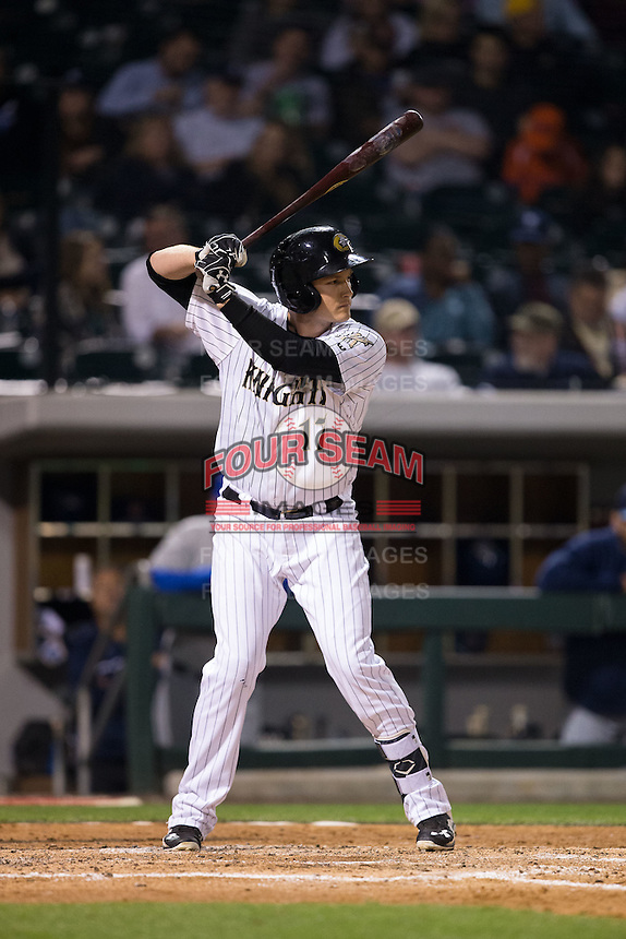Jason Coats (17) of the Charlotte Knights at bat against the Durham Bulls at BB&T BallPark on April 14, 2016 in Charlotte, North Carolina.  The Bulls defeated the Knights 2-0.  (Brian Westerholt/Four Seam Images)