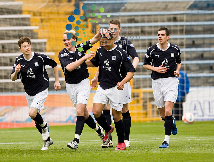 Leighton McIintosh is congratulated by team mates after scoring during The Irn-Bru First Division match between Greenock Morton and Dundee at Cappielow 16/04/11 ..Picture by Ricky Rae/universal News & Sport (Scotland).
