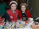 Sisters Chloe and Emma Kiernan selling their home made buns and cakes at the Stamullen Christmas market. Photo:Colin Bell/pressphotos.ie