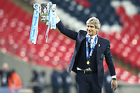Manuel Pellegrini (Manager) of Manchester City hold the Capital One Cup alof after the Capital One Cup match between Liverpool and Manchester City at Wembley Stadium, London, England on 28 February 2016. Photo by David Horn / PRiME Media Images.
