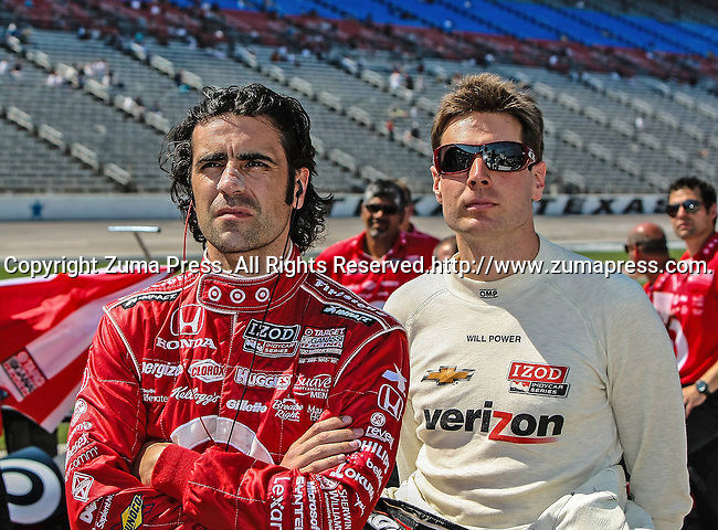 Scott Dixon (9) driver of the Target Chip Ganassi Racing car and Will Power (12) driver of the Verizon Team Penske car watch the action during qualifying for the IZOD Indycar Firestone 550 race at Texas Motor Speedway in Fort Worth,Texas. IZOD Indycar driver Alex Tagliani (98) driver of the Team Barracuda-BHA car qualifies in the top spot during the Firestone 550 race...