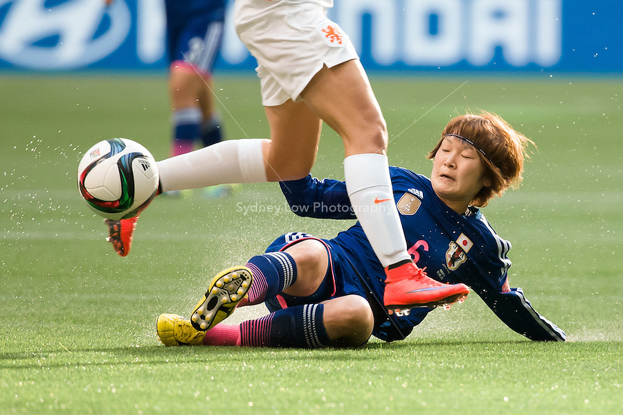 June 23, 2015: Lieke MARTENS of Netherlands is tackled by Mizuho SAKAGUCHI of Japan during a round of 16 match between Japan and Netherlands at the FIFA Women's World Cup Canada 2015 at BC Place Stadium on 23 June 2015 in Vancouver, Canada. Japan won 2-1. Sydney Low/AsteriskImages.com