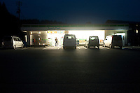 Landscape view of a Family Mart convenience store at night following the 311 Tohoku Tsunami in Motoyoshi, Japan  © LAN