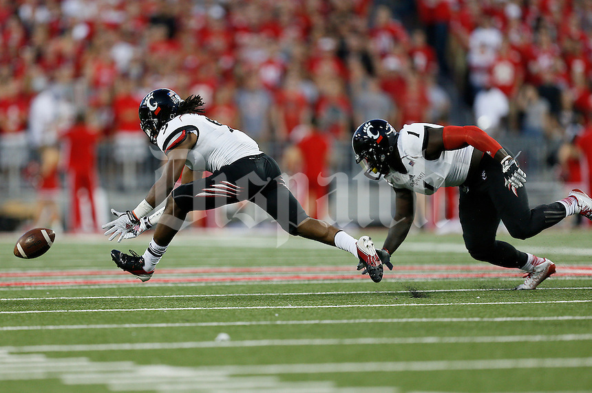 Cincinnati Bearcats cornerback Leviticus Payne (9) chases after an Ohio State fumble in the second quarter of the college football game between the Ohio State Buckeyes and the Cincinnati Bearcats at Ohio Stadium in Columbus, Saturday afternoon, September 27, 2014. As of half time the Ohio State Buckeyes led the Cincinnati Bearcats 30 - 21. (The Columbus Dispatch / Eamon Queeney)