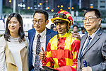 Jockey Karis Teetan, who rode #12 Trendiful, (R2) and trainer Jimmy Ting Koon-ho (L2) pose for photo after winning race 4 during Hong Kong Racing at Happy Valley Racecourse on October 24, 2018 in Hong Kong, Hong Kong. Photo by Yu Chun Christopher Wong / Power Sport Images