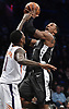 Spencer Dinwiddle #8 of the Brooklyn Nets draws a foul on Jamal Crawford #11 of the Phoenix Suns during an NBA game at the Barclays Center in Brooklyn, NY on Sunday, Dec. 23, 2018. Dinwiddle scored a team-high 24 points to lead the Nets to a 111-103 win.