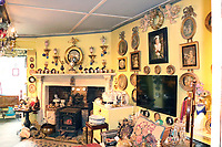 BNPS.co.uk (01202 558833)<br /> Pic: Woolley&Wallis/BNPS<br /> <br /> The 'Maximalist' interior of avid collector Judith Howard's modest terraced home in Wiltshire. <br /> <br /> One woman's lifetime collection of French porcelain that filled 'every nook and cranny' of her modest home sold for £373,000 yesterday, over £125,000 over estimate.<br /> <br /> The late Judith Howard's passion for 18th century gallic ceramics saw the walls, shelves and display cabinets adorned with hundreds of plates, dishes and bowls.<br /> <br /> She was well known for having an eye for a bargain, so much so that a 250-year-old plate she bought for £13 at an antiques shop sold for £31,000.<br /> <br /> The item was once part of the 1,735 dinner service set made for French King Louis XV and housed in the Palace of Versailles.