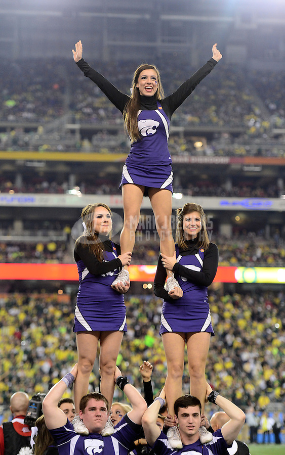 Jan. 3, 2013; Glendale, AZ, USA: Kansas State Wildcats cheerleaders perform a pyramid against the Oregon Ducks during the 2013 Fiesta Bowl at University of Phoenix Stadium. Oregon defeated Kansas State 35-17. Mandatory Credit: Mark J. Rebilas-