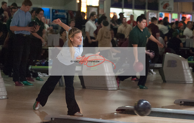 Chugiak's Leilani Fugere lets fly at Central Bowl, Thursday, Dec. 8, 2016.  Photo for the Star by Michael Dinneen