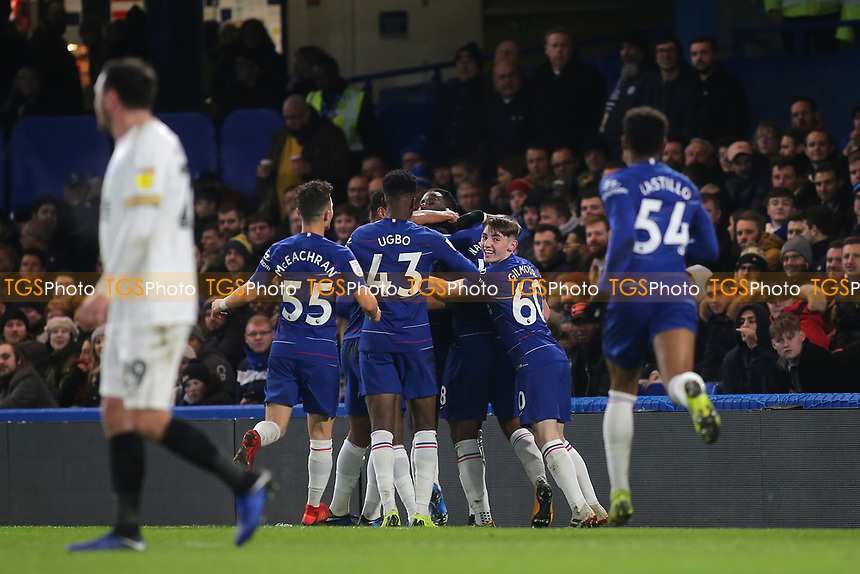 Chelsea players congratulate Richard Nartey after scoring their opening goal during Chelsea Under-21 vs Peterborough United, Checkatrade Trophy Football at Stamford Bridge on 9th January 2019