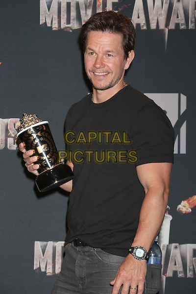 LOS ANGELES, CA - APRIL 13: Mark Wahlberg in the press room at the 2014 MTV Movie Awards at Nokia Theatre L.A. Live on April 13, 2014 in Los Angeles, California. <br /> CAP/MPI/JO<br /> &copy;Janice Ogata/MPI/Capital Pictures