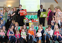 (L-R in the centre of the picture) Aldi area managers Matt Wright with Dayo Layinka and Steph Palmer of the parent and toddler group.
