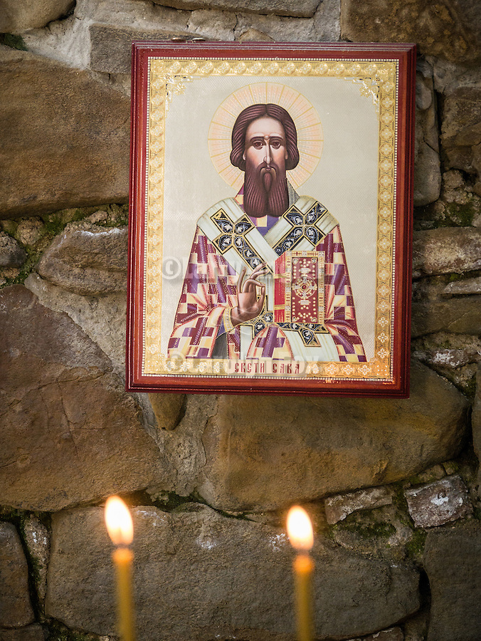 Vigil candles and icon of St. Sava, Candle chapel, Church of the 40 Martyrs of Sebaste, constructed in 1230 and the place of repose (death) of St. Sava in 1236.<br /> <br /> Veliko Tarnovo, Bulgaria