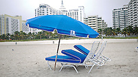 A pair of blue lounges and umbrellas on the beach early on a cool morning at South Beach, Miami Beach, Florida...(Photo by Brian Cleary/www.bcpix.com)