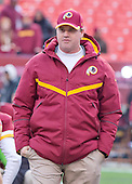 Washington Redskins head coach Jay Gruden watches as his team warms-up prior to the game against the Philadelphia Eagles at FedEx Field in Landover, Maryland on Saturday, December 20, 2014.<br /> Credit: Ron Sachs / CNP