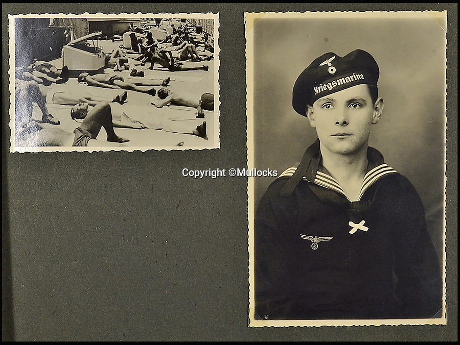 BNPS.co.uk (01202 558833)<br /> Pic: Mullocks/BNPS<br /> <br /> A German sailor's personal photo album capturing Hitler's visit to his doomed ship on which almost 2,000 men later perished has emerged for the first time. <br /> <br /> Showing the Fuhrer inspecting the ill-fated crew and greeting senior personnel, the 81 images were taken on board the infamous Nazi battleship Scharnhorst between 1939 and 1940. <br /> <br /> The 771ft vessel was sunk during the Battle of the North Cape in 1943 by HMS Duke of York with only 36 of a crew of 1,968 surviving. <br /> <br /> And this album, compiled by an unidentified German sailor, shows what life was like on Scharnhorst before that day. It will be sold by Mullocks Auctions in Shropshire on October 18 with a £650 estimate.