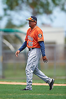 GCL Astros pitching coach Erick Abreu (26) walks to the mound during a game against the GCL Nationals on August 14, 2016 at the Carl Barger Baseball Complex in Viera, Florida.  GCL Nationals defeated GCL Astros 8-6.  (Mike Janes/Four Seam Images)