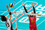 Wing spiker Rika Nomoto of Japan (L) spikes the ball during the FIVB Volleyball World Grand Prix match between China vs Japan on July 21, 2017 in Hong Kong, China. Photo by Marcio Rodrigo Machado / Power Sport Images
