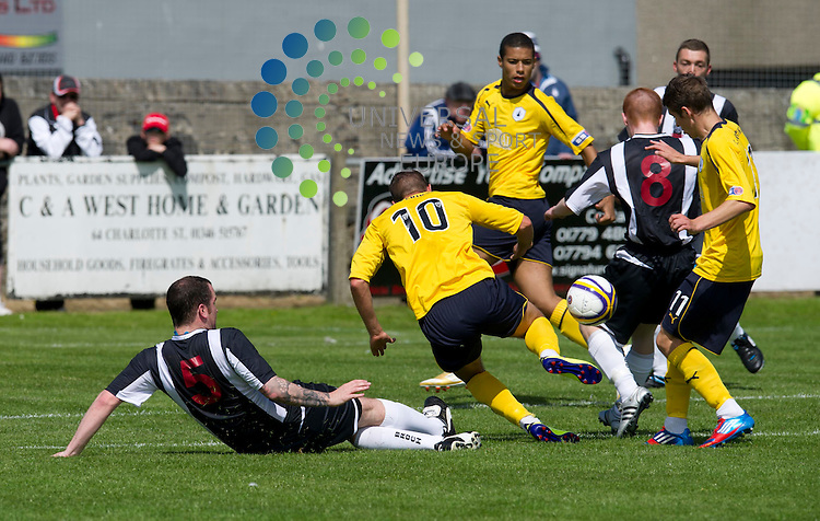 Andy Haworth of Falkirk challenges for the ball against Ryan Christie of Fraserburgh during the preseason friendly between Fraserburgh and Falkirk at Bellslea Park, Fraserburgh.  14 July 2012. Picture by Ian Sneddon / Universal News and Sport (Scotland). All pictures must be credited to www.universalnewsandsport.com. (Office) 0844 884 51 22.