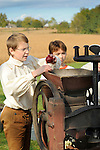 Heritage Days Festival. Union County. Colonial boy putting apples in cider press.