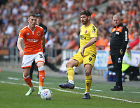 Fleetwood Town's Ched Evans and Blackpool's Chris Long<br /> <br /> Photographer Stephen White/CameraSport<br /> <br /> The EFL Sky Bet League One - Blackpool v Fleetwood Town - Monday 22nd April 2019 - Bloomfield Road - Blackpool<br /> <br /> World Copyright © 2019 CameraSport. All rights reserved. 43 Linden Ave. Countesthorpe. Leicester. England. LE8 5PG - Tel: +44 (0) 116 277 4147 - admin@camerasport.com - www.camerasport.com