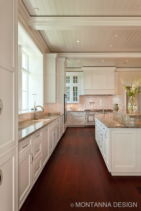 White inset panel cabinets contrast nicely with the dark wood floors for a clean and classic crisp look