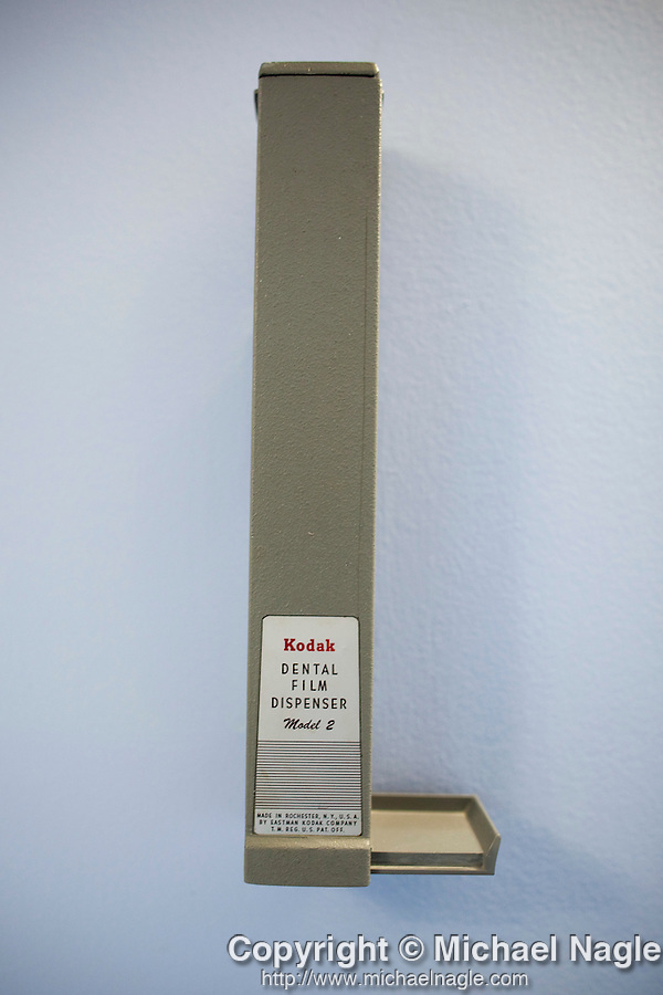 DOBBS FERRY, NY - FEBRUARY 03, 2011:  Dr. Edward Zuckerberg, D.D.S.,  father of Facebook founder Mark Zuckerberg, keeps his lead-cased x-ray film dispenser on the wall in his dental practice as a antique decoration on February 03, 2011 in Dobbs Ferry, NY.  He's switched to digital x-rays.  (Photo by Michael Nagle)