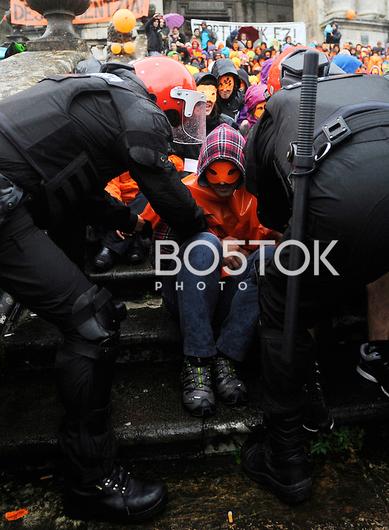 Basque police moves people out of the way in order to reach 5 young people on September 22, 2014 in Azpeitia, Basque Country. Hundreds of people gathered outside the Loiola Basilica to prevent the incarceration of Jazint Ramirez, Irati Tobar, Igarki Robles, Imanol Salinas and Xabier Arina after an arrest warrant was issued by the Spanish Court against them after they have not appeared in court for the start of a trial against 28 Basque youth accused of belonging to Basque youth organization SEGI. (Ander Gillenea / Bostok Photo)