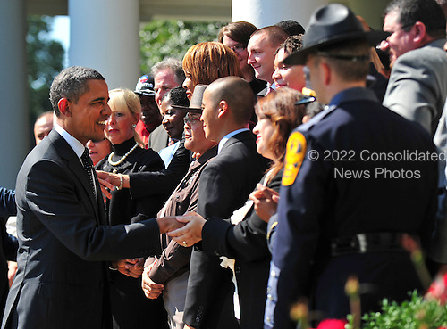 United States President Barack Obama greets civil servants who will be helped by his jobs bill after delivering a statement on his bill in the Rose Garden at the White House in Washington on September 12, 2011.  .Credit: Kevin Dietsch / Pool via CNP