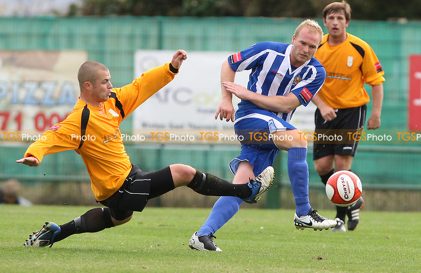 Sam Collins of East Thurrock challenges Dave Collis of Hornchurch - East Thurrock vs AFC Hornchurch, Ryman League at Rockery Hill, East Thurrock - 08/10/11 - MANDATORY CREDIT: Rob Newell/TGSPHOTO - Self billing applies where appropriate - 0845 094 6026 - contact@tgsphoto.co.uk - NO UNPAID USE.