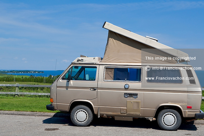 A Westfalia with his Pop top open is pictured against the Lac St-Jean lake in the province of Quebec, July 18, 2009.