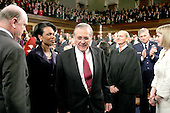 United States Secretary of Defense Donald Rumsfeld, center, arrives in the United States House of Representatives Chamber for  United States President George W. Bush's State ofthe Union Address to a Joint Session of Congress in the Capitol in Washington, D.C. on February 2, 2005.  Also visible, from left to right: United States Secretary of the Treasury John Snow; United States Secretary of State Condoleezza Rice; Rumsfeld; Associate Justice of the United States Supreme Court: Air Force General Richard Myers, Chairman of the Joint Chiefs of Staff; and an unidentified woman.<br /> Credit: Luke Frazza / Pool via CNP