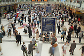 A crowd of commuters at Liverpool Street Station during the London rush hour